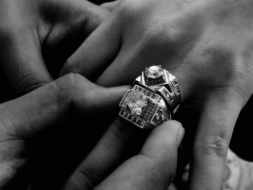 person wearing two diamond rings