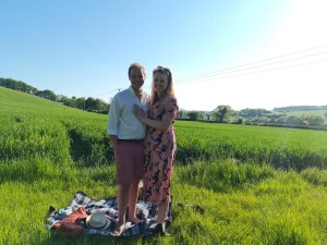 Engaged Couple In Field