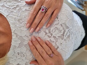 Woman With Ruby Rings on Each Hand