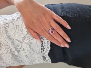 Woman With Ruby Engagement & Wedding Rings